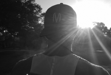 Athlete running with a Mind Right Endurance Hat Backwards